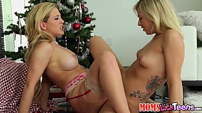 Christmas mom and teen scissoring each other by the tree with Cherie Deville and Zoey Monroe