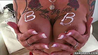 Lusty pornstar with big boobs Anna Bell Peaks puts some cream on them