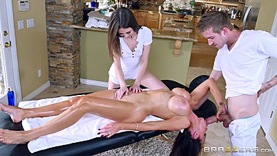 Two for one fun during massage with Nikki Benz and Riley Reid
