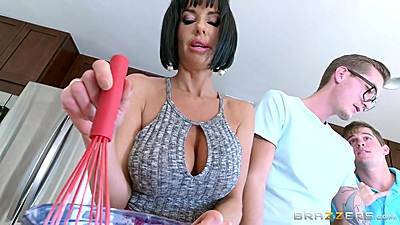 Milf Veronica Avluv is whipping something up in kitchen