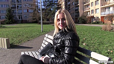 Approaching Nikky Dream on a public euro bench to offer some money