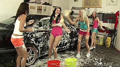 Car wash party time with soaped up youngsters
