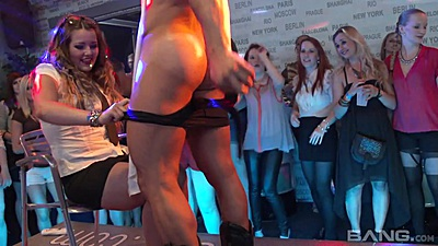 Horny ladies do cfnm blowjob with male stripper on stage