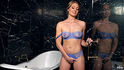 Mischievous little Veronica Weston having fun in the tub with soap