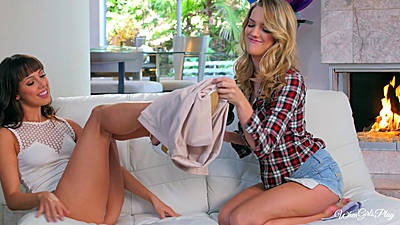 Kenna James and Jenna Sativa helping each other with clothes off