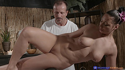 Natural breasts Russian milf Eva Ann laying down for oil massage