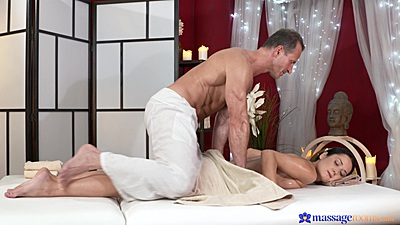 Male masseuse giving a naked girl Angie a rub