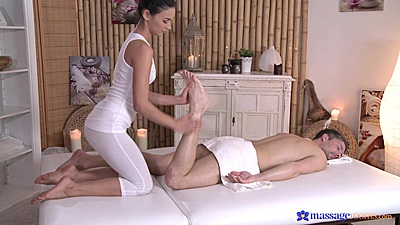 Female masseuse in yoga pants Keira giving a foot rub