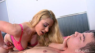 Cathy Heaven is jerking a cock while wearing bright pink bras and panties