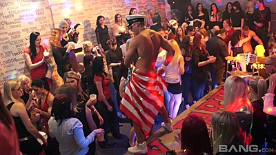 Dancing male stripper with horny girls watching him