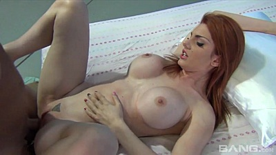 Redhead with big juggs Lilith Lust spread legs sex