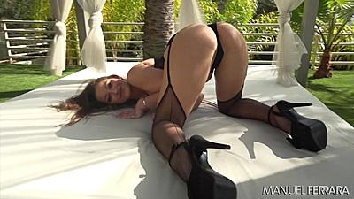Posing her ass Dani Daniels outdoors in high heels