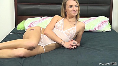 Petite solo lingerie Maddison Callaway laying on bed and preparing for some fun