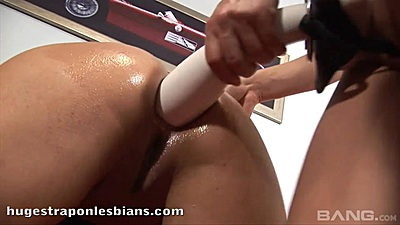Huge strap on lesbian ass penetration with rimjob