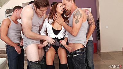 Megan Rain busy jerking dicks and sucking them with deep throat in gang bang