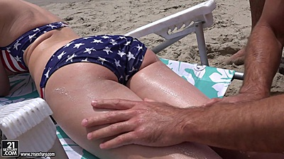 Staci Carr getting some lotion on the beach