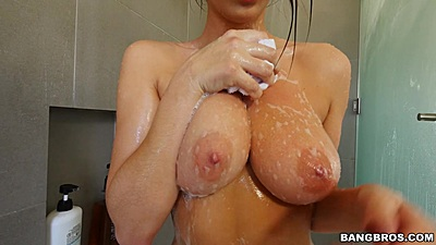 Heated busty Ashley Adams taking a shower and soaping her tits