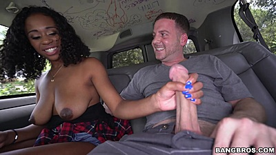 Ivy Young jerks dick reaching over then puts in the mouth