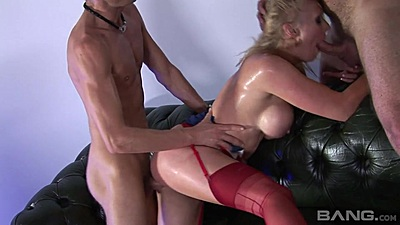 Two male mechanics nailing a busty blonde whore right in their garage