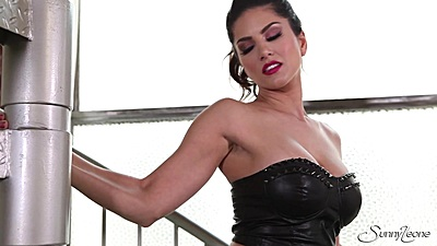 Sexy honey babe Sunny Leone in glamcore striptease