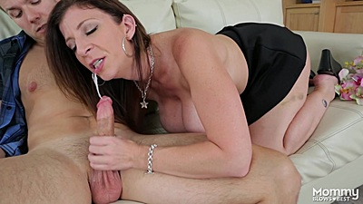 Excited busty milf Sara Jay giving head with some liquids