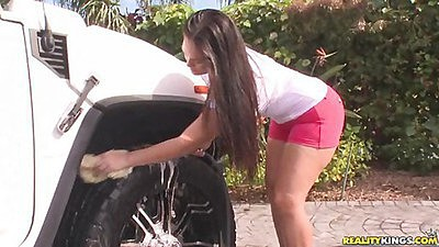 Sexy big tits chick all covered in soap washing a car