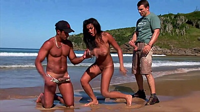 Busty doll Babalu on the beach with two men