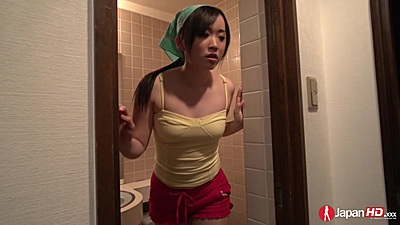 Asian vixen Yuka Wakatsuki sits on toilet and plays with self