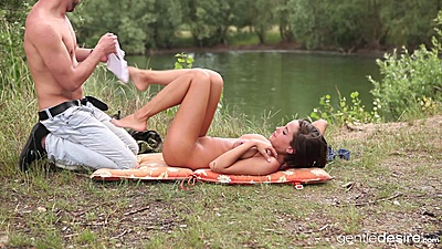 Anabelle gets naked and fucks after fishing on a picnic
