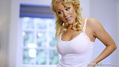 Busty milf Rebecca Jane Smyth wearing a tank top needs to teach this video gamer a lesson