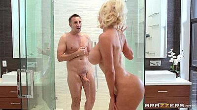 Super busty Nicolette Shea joins man in shower