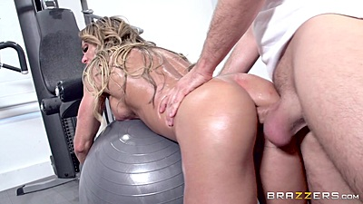 Bent over the exercise ball at the gym with oiled up anal rammed milf Nina Dolci