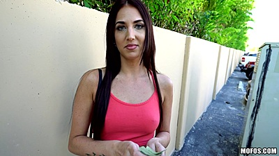 Brunette clothed girl Aubrey Rose accepts money in a public parking to suck some dick