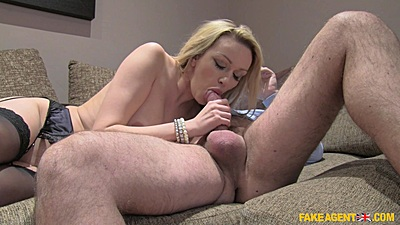 Solid milf Amber Jayne giving head to male agent in office