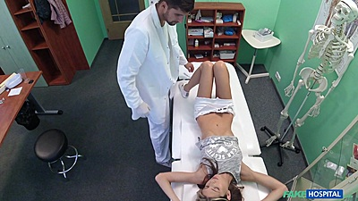 Shy Russian patient Gina Gerson lays on bed for doctor to check