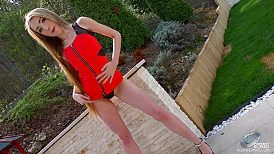 Shameless Empera in naughty red outfit outdoors