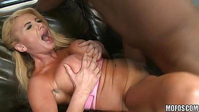 Big tits milf spreads her leg