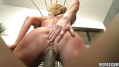 Milf sitting and ripping her tight pussy on black cock