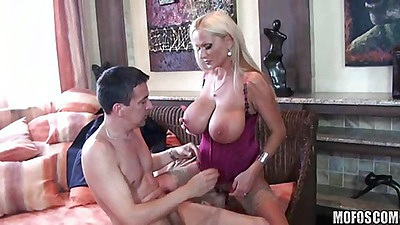 Big tits blonde milf taking a cock between tits