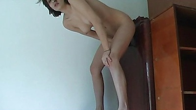 Slut inserting and sitting on dildos