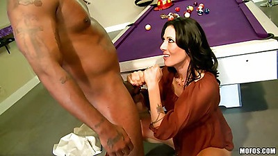 Brunette milf goes down on large black dick