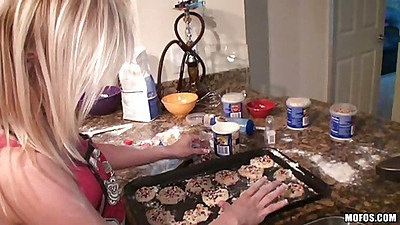 Hot amateur getting dirty in the kitchen cooking
