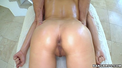 Massage time with asian babe Katsuni oiled up and tits massaged
