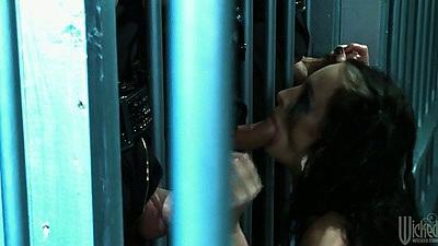Alektra Blue sucking cocks through bars in prison
