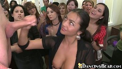 Big tits slut pulls out her bare tits and jerks dancing bear till he cum