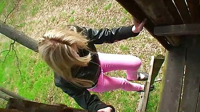 Teen KerryYoung climbing to jerk and suck dudes cock outdoors