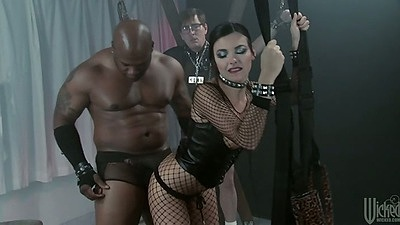 Fetish with Danica Dillon in fishnet and chained up on sex swing