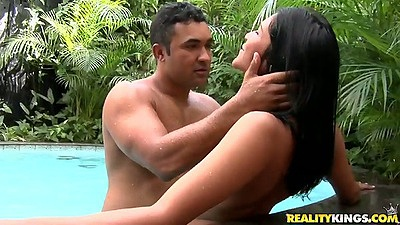 Latina babe Manuela Amorina makes out with guy outdoors by pool