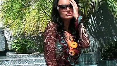 Outdoor glamcore babe Alektra Blue posing in a bikini solo