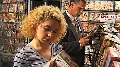 Sex store with Kiki Daire sucking some dick in the back